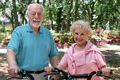 An attractive senior couple out for a bike ride together.