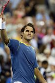 FLUSHING, NY - SEPTEMBER 4: Roger Federer of Switzerland gestures to the crowd after defeating Olivier Rochus of Belgium during the U.S. Open September 4, 2005 in Flushing, New York.