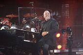 FLUSHING, NY - JULY 16: Singer Billy Joel performs at Shea Stadium on July 16, 2008 in Flushing, New York.