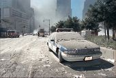 NEW YORK - SEPTEMBER 11:  A Port Authority police vehicle lies covered with ash near the area known