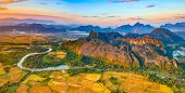 Aerial view of the fields, river and mountain. Beautiful landscape panorama. Vang Vieng. Laos. poster