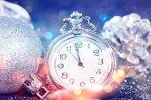 New Years at midnight - Old clock with stars snowflakes and holiday lights poster