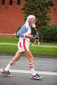 MOSCOW, RUSSIA - SEPTEMBER 12: Old man runs on Kremlin embankment in XXX Moscow International Peace Marathon on September 12, 2010 in Moscow, Russia. It is annual festival of racing for all people.