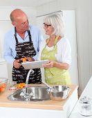 Senior couple preparing apricot jam