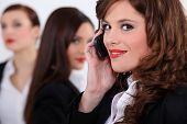 Attractive businesswomen with a cellphone