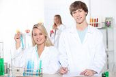 stock photo of cytology  - young woman and young man in a laboratory - JPG