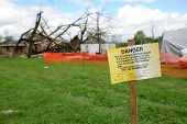 SAINT LOUIS, MO - APRIL 22:Sign in front of destruction left behind by tornadoes that ravaged the ar