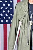 Close up of American veteran with crutch and flag in background