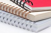 Closeup of Three Spiral Bound Notebooks with shallow Depth of Field. Horizontal Framed Image.