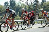 RUNNING SPRINGS, CA - MAY 21: Three cyclists tackle Stage 6 of the Amgen Tour of California on May 2