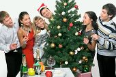 stock photo of christmas party  - Young positive happy people are celebrating Christmas - JPG