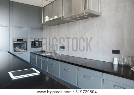 poster of Modern Kitchen With Faucet, Kitchen Hood, Mirror, Oven. Modern Smart Kitchen