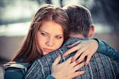 stock photo of breakup  - conflict and emotional stress in young people couple relationship outdoors - JPG