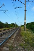 Railway Track, Railway And Electric Power Lines For Electric Vehicles, Electric Trains Lying Along C poster