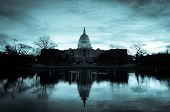 Washington DC, Capitol Building in a cloudy sunrise with mirror reflection - split toned