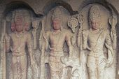 Hindu Gods Carved On The Walls Of A Cave Temple