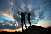 Teamwork Couple Helping Hand Trust Help, Silhouette Success In Mountains. Team Of Climbers Man And W poster