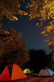 Tourists Tent Camp Under Amazing Starry Night Sky With Milky Way And Stars In Mountains. Camping Und poster