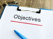Paper With Text Objective On Wood Table poster