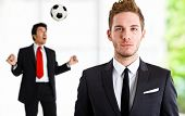 Employee playing soccer while his boss cannot see him