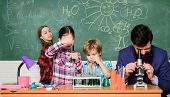 Man Bearded Teacher And Pupils With Test Tubes In Classroom. Observe Reaction. Science Is Always The poster