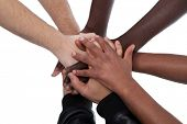 Many multiracial hands coming together as a team!