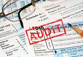 stock photo of treasury  - Federal tax forms being audited - JPG