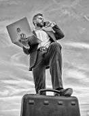 Man Well Groomed Businessman Holds Laptop Blue Sky Background. Guy Formal Suit Modern Technology Man poster