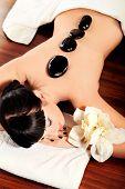 Beautiful woman relaxing in a spa salon.
