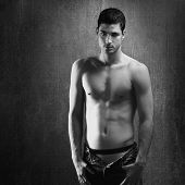 Black and white sexy young denim shirtless man on retro grunge background