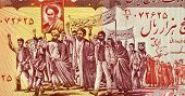IRAN - CIRCA 1983: Mullahs Leading Marchers Carrying Posters of Khomeini on 5000 Rials 1983 Banknote