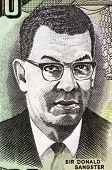 JAMAICA - CIRCA 2007: Donald Sangster (1911-1967) on 100 Dollars 2007 Banknote from Jamaica. Jamaican politician and the second Prime Minister of Jamaica.