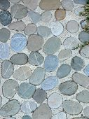 stock photo of pavestone  - Detail of a cobble brick road - JPG