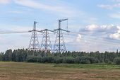 Group Silhouette Of Transmission Towers Power Tower, Electricity Pylon, Steel Lattice Tower . Textur poster