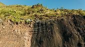 Workers Strengthen The Slope Of The Mountain With Metal Mesh Preventing Rockfall And Landslide On Th poster