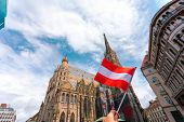 St. Stephens Cathedral On The Main Square Of Vienna In The Old Town With The Flag Of Austria In Fema poster