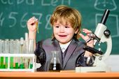 Explore Biological Molecules. Toddler Genius Baby. Boy Near Microscope And Test Tubes In School Clas poster
