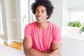 African American business man wearing pink casual t-shirt smiling looking side and staring away thin poster