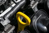 Yellow Oil Dipstick In Car Engine. Measuring Level Of Engine Oil. Dipstick Oil Level Gauge With Yell poster
