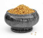 foto of fenugreek  - Fenugreek seeds in a mortar with marble gray - JPG