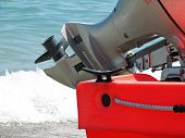 foto of outboard  - Orange boat engine - JPG
