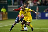 CARSON, CA. - APRIL 9: Columbus Crew F Emilio Renteria #20 & Chivas USA M Michael Lahoud #11 during