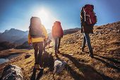 Group Of Hikers Walking On A Mountain At Autumn Day poster