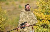 Man Brutal Gamekeeper Nature Background. Regulation Of Hunting. Hunter Hold Rifle. Bearded Hunter Sp poster