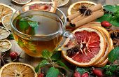 Cup Of Mint Tea On A Wooden Table. Dried Citrus Fruits, Mint Leaves, Rose Hips And Brewed Mint. Alte poster