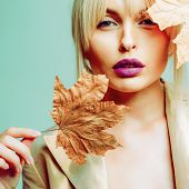 Autumn Woman. Hello September. Model Face Close-up. Autumnal Foliage. Autumn Clothing. Autumn Leaves poster