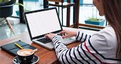 Close Up Woman Type On Laptop Keyboard And Looking At Computer Screen On Table In Coffee Shop,blank  poster