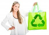 Woman recycling with a reusable bag - isolated over white