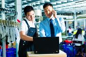 Worker or production manager and customer service, look on a laptop in a textile factory and help on the phone