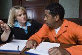 Female advocate in conversation with prisoner